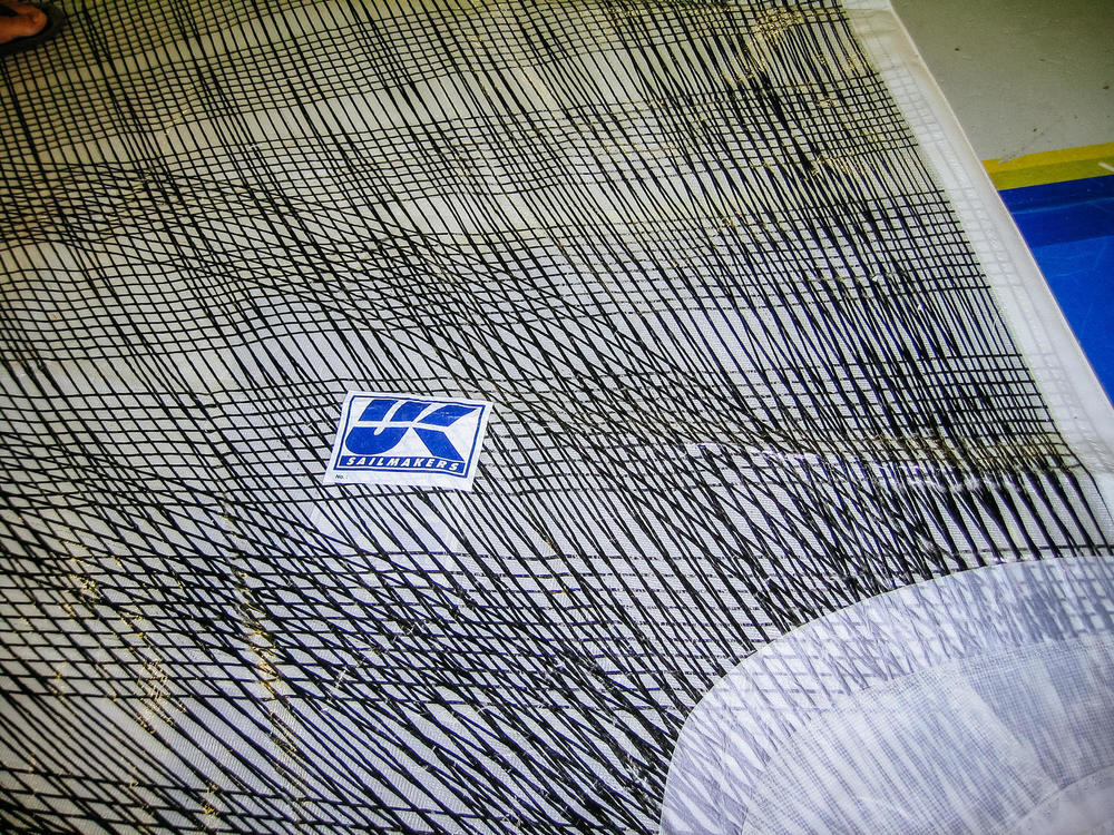 Detail showing the extensive coverage of tapes are on an X-Drive sail.