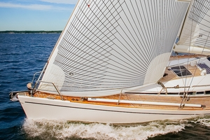 Tape-Drive Carbon/ Polyester   Description:  For club racers, Tape-Drive carbon sails made with polyester laminates offer plenty of performance a significant savings.      Boat size:   20-45 feet   Construction:   Cross-cut broad-seamed panels reinforced with continuous carbon fiber tapes bonded to the sails surface. The cross-cut panels define the sail's shape and the grid of tapes carries the primary loads of the sail to lock in sail shape.     Material:  Cross-cut panels are made of a loose weave of polyester yarns laminated between layers of Mylar. Some polyester laminates have a single layer of polyester taffeta for abrasion resistance. The carbon tapes are made with 14,000 or 28,000 filaments of carbon.    Shape Stability:  ★★★     Longevity:  ★★★★   Shape after   500 hours:  Circa 70%   Price:  $$$
