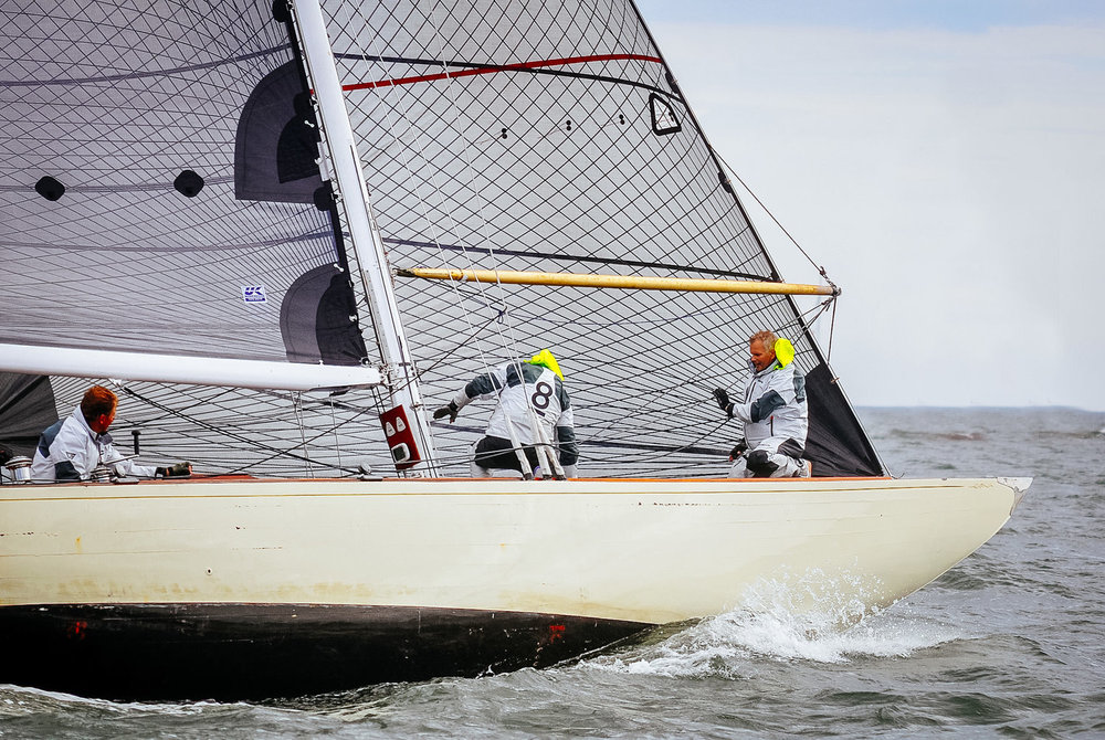 An 8-Meter with Tape-Drive carbon black aramid sails.