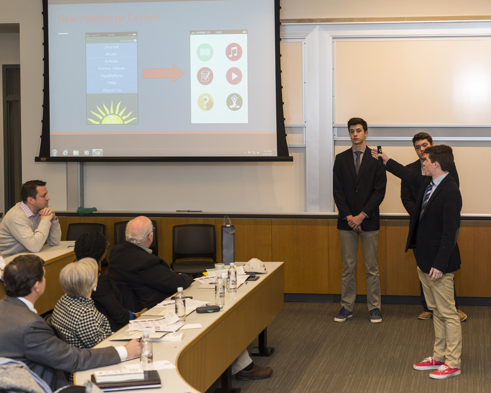 Malvern Prep Social Entrepreneurship students presenting to a CEO panel the prototype of an app that increases a positive mood to help mitigate suicidal thinking and behaviors. (Phoot credit: Bob Colameco)