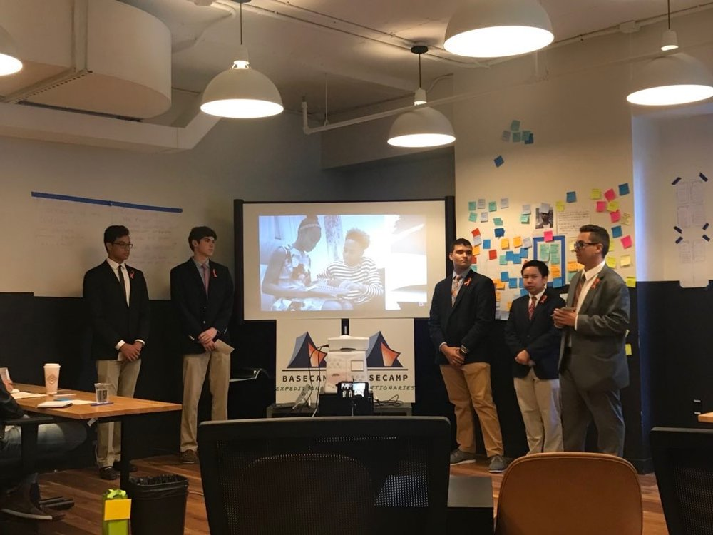 "The Fordham Prep team of Expeditionaries begins their project pitch to the CEO panel with a ""day in the life"" story of the people with whom they sought to experience kinship, whom they hope to help with their social innovation prototype concept."