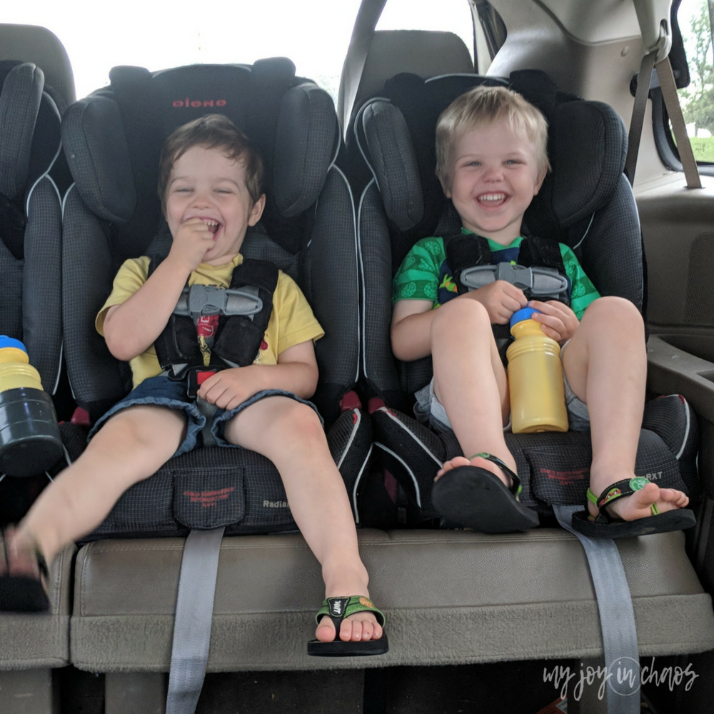 waiting in the car - 3 car seats across - diono radian car seats