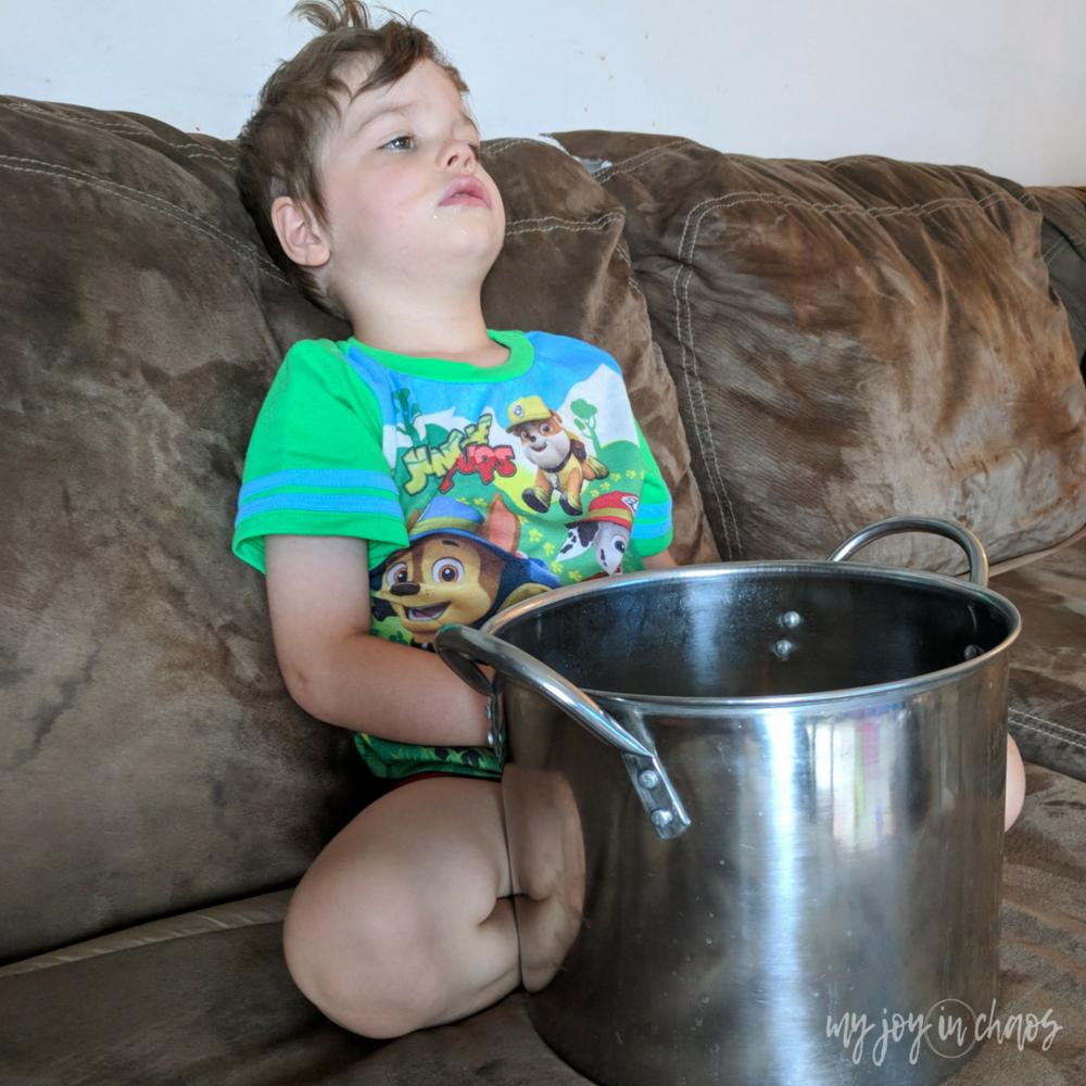 sick preschooler with big bucket