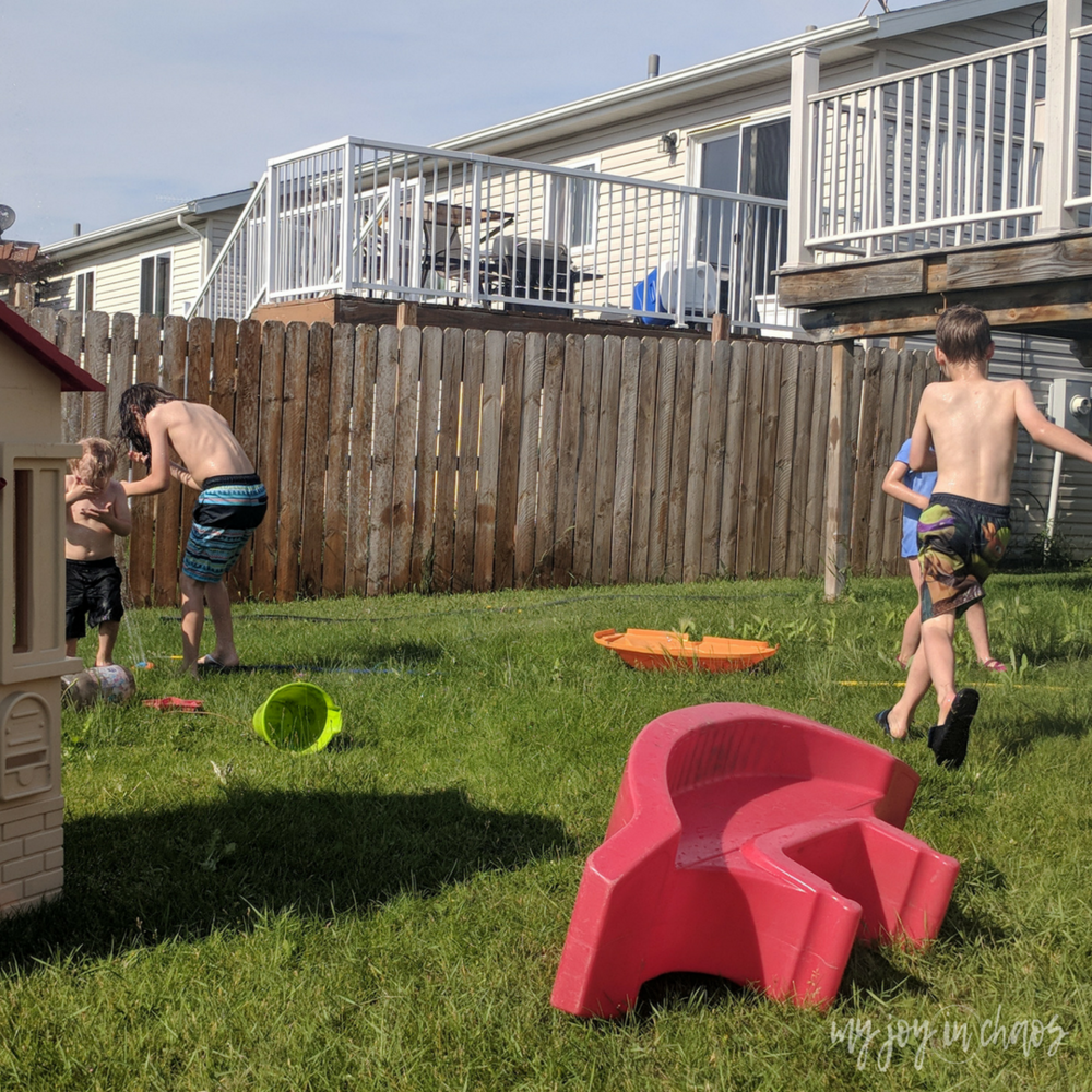 use the sprinkler for easy and cheap fun on hot days