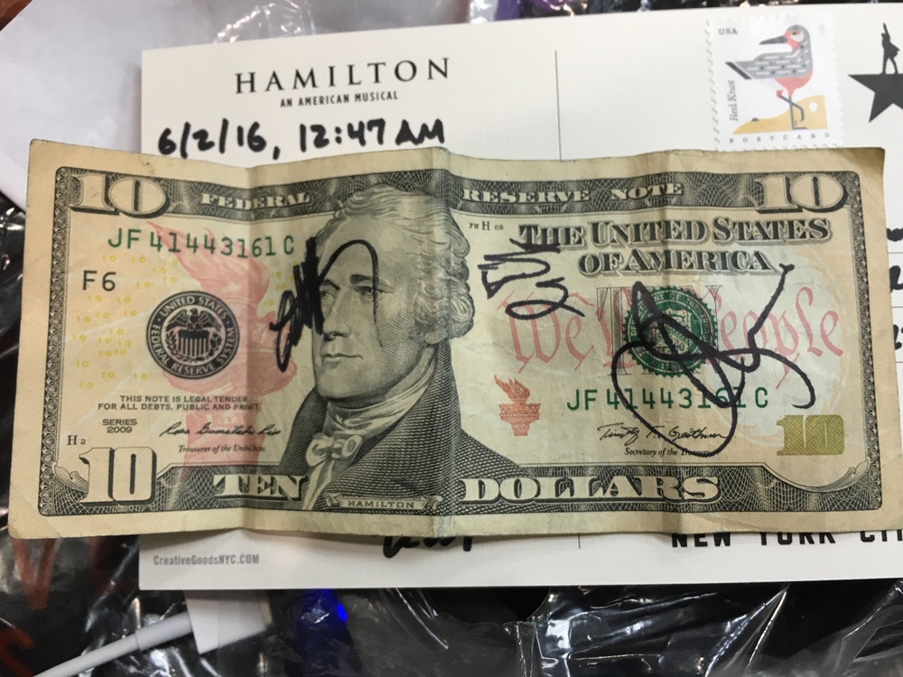 Rob's $10 bill signed by Hamilton cast members.