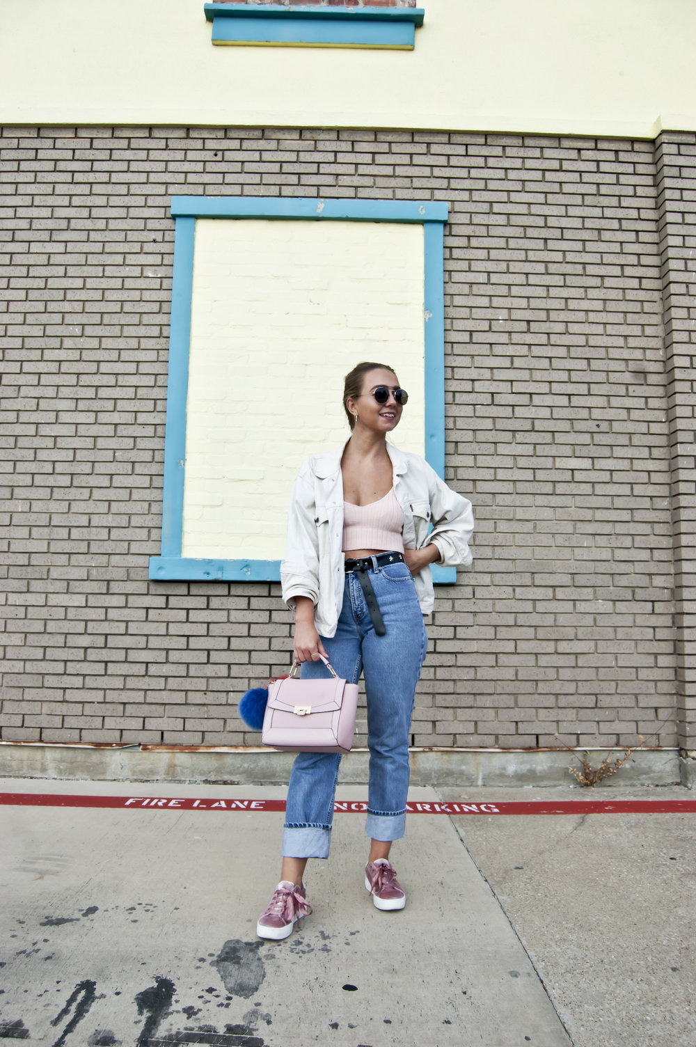 I am wearing sunglasses from Sprouts, find similar here // crop top from Zaful.com, find it here // my boyfriends old denim jacket, find similar here // vintage jeans, find similar here // silver hoop earrings from target, find here // bag from target, find similar here // sneakers from Steve Madden, find here // fur pom poms from Dalpaca, find here.