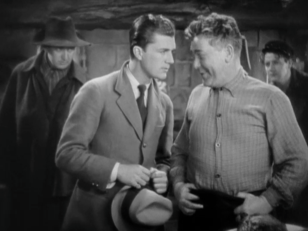 Hurst as an extra (left in hat) in John Ford's  Hangman's House . (1928) Copyright Twentieth Century Fox Inc.