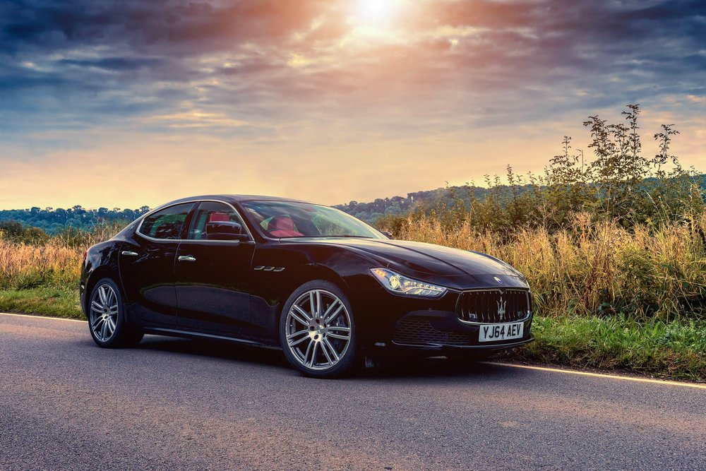 Maserati Ghibli parked on the road to the Cotswolds