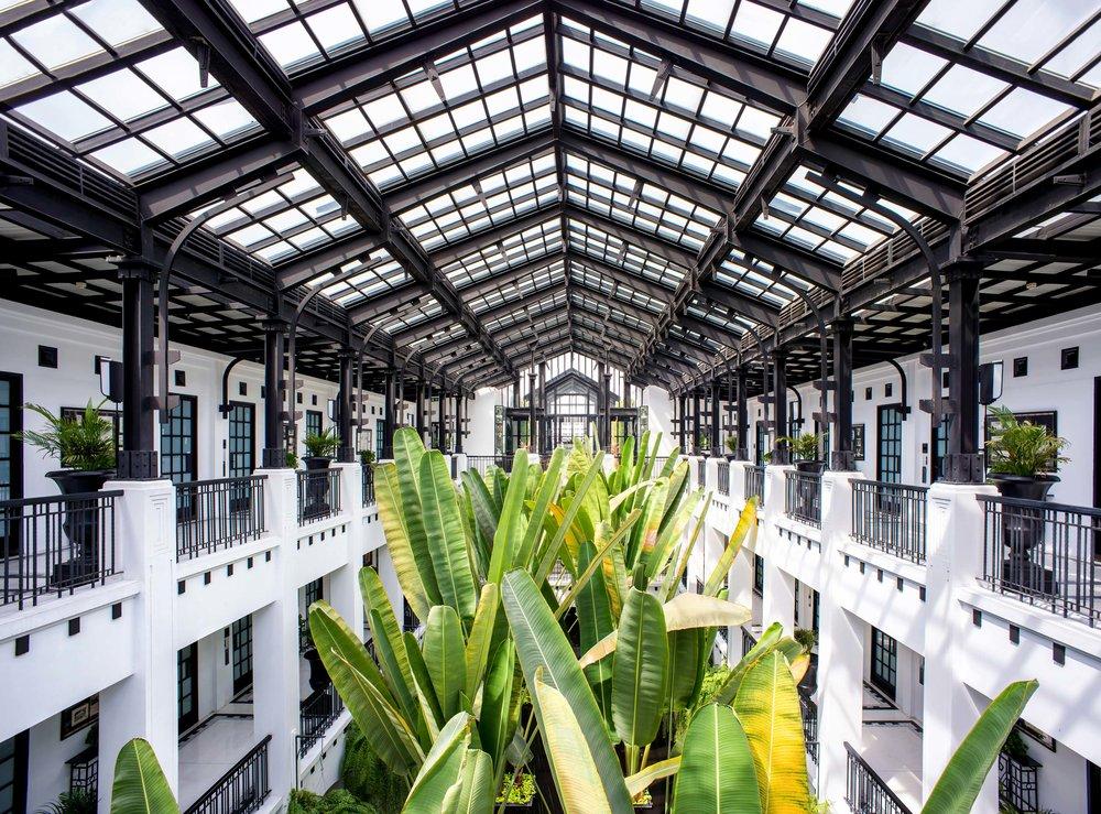 The Siam hotel Atrium housing Banana Palms