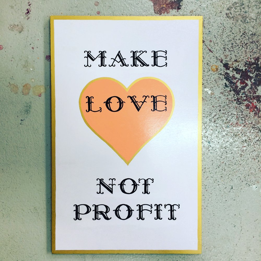 'Make Love Not Profit' sign writers paint on wood, 65 x 41cms, 2015