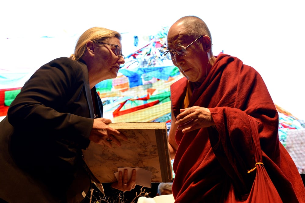 Lynn Bain, General Manager of Dalai Lama in Australia presenting His Holiness the Dalai Lama with the book of Birthday Wishes, 2015 Photo credit: Rusty Stewart, courtesy of Dalai Lama in Australia Ltd.