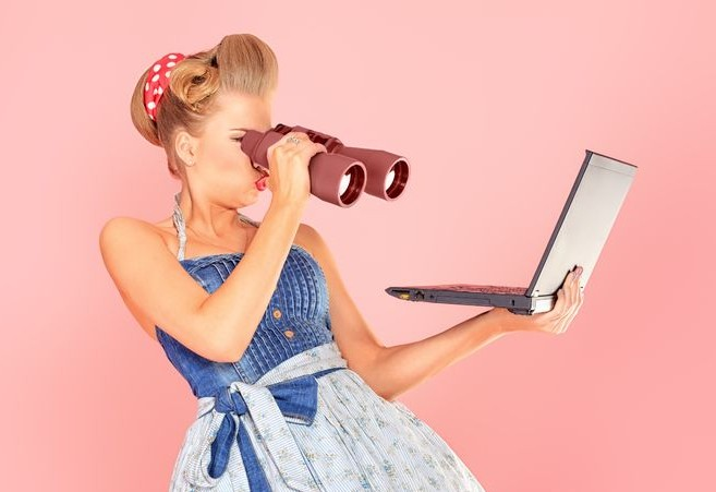 woman-looking-at-computer-through-a-pair-of-binoculars-e1425067414344.jpg