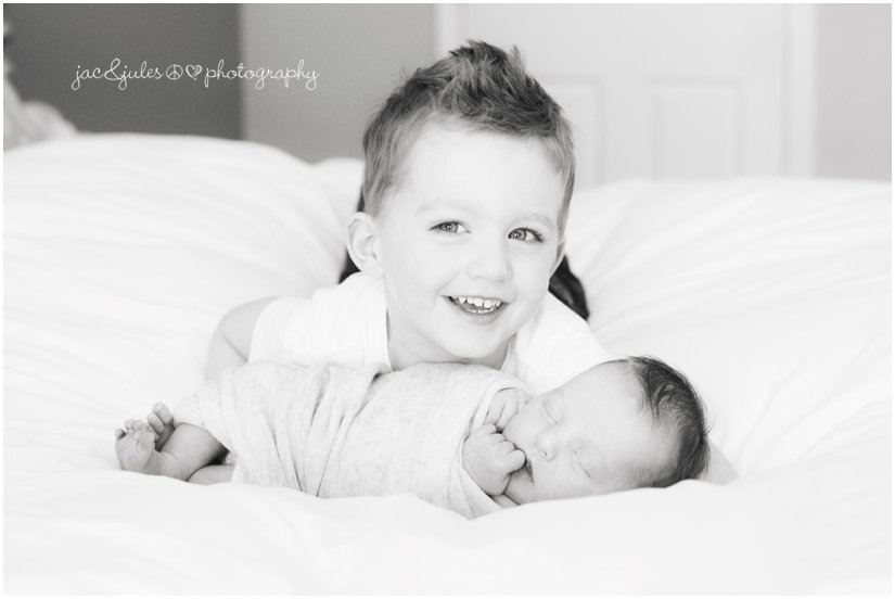 big brother with newborn baby sister black and white