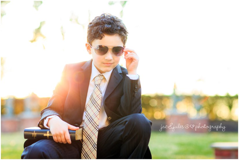 unique photo of the communion boy at the manor by west orange, nj family photographer jacnjules