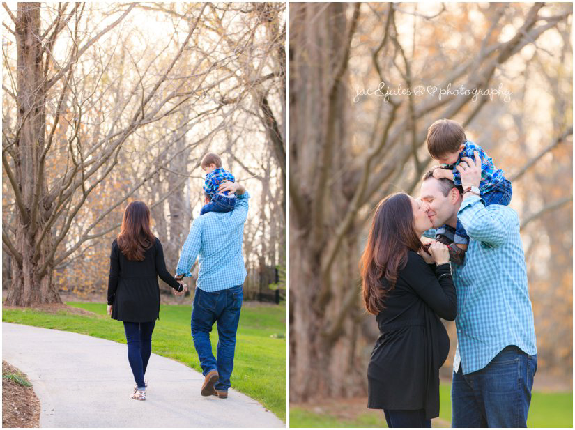mom dad and son kiss over baby bump by jacnjules at deep cut gardens in Holmdel, NJ