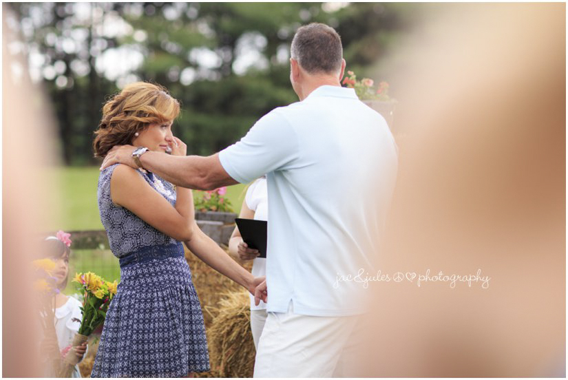 bride crying during ceremony at farm wedding