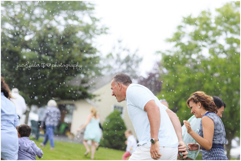 starts to rain during outdoor farm wedding ceremony