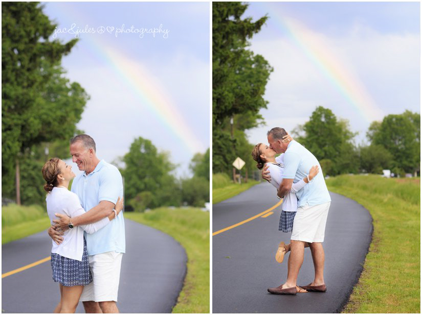wedding couple in the road under a rainbow after the rain