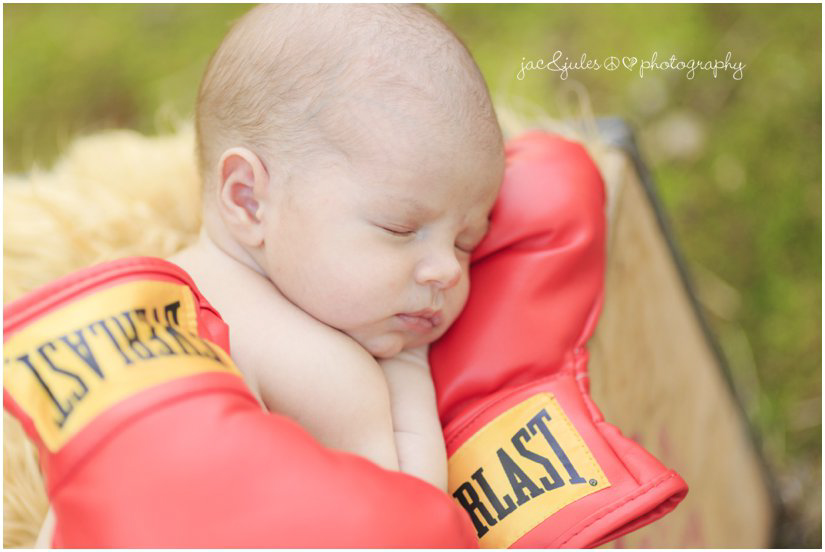 newborn baby with boxing gloves