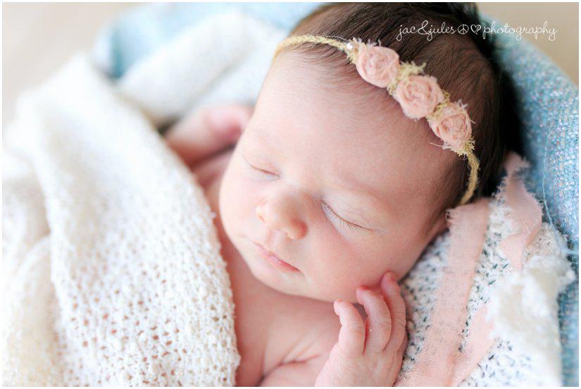 newborn baby girl by professional newborn photographers jacnjules