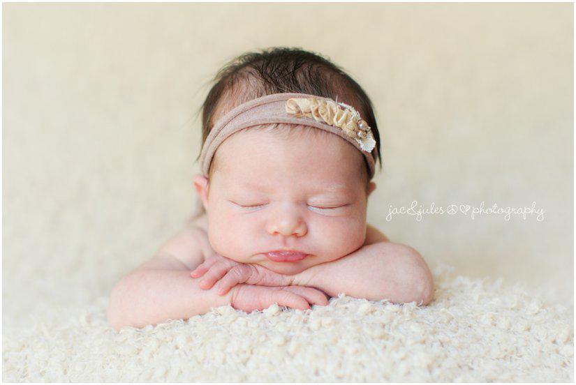 newborn baby girl by professional newborn photographers jacnjules headband by emmy blue handmade