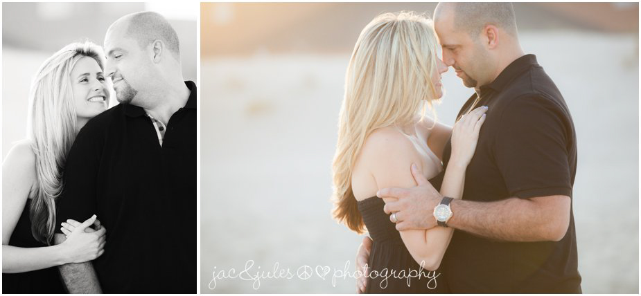 Candid loving moments of a couple in matching black outfits on beautiful beach in Lavallette, NJ photographed by JacnJules