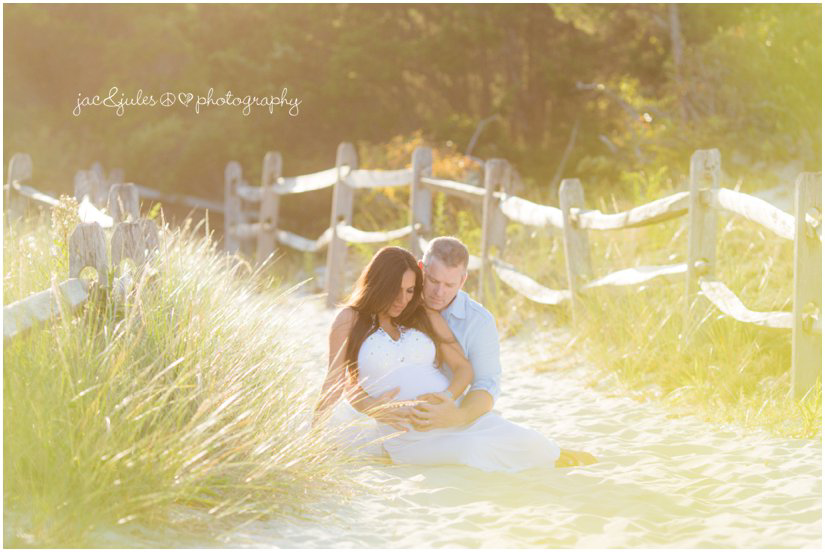 A couple embraces at Island Beach State Park, NJ awaiting their newest edition by JacnJules