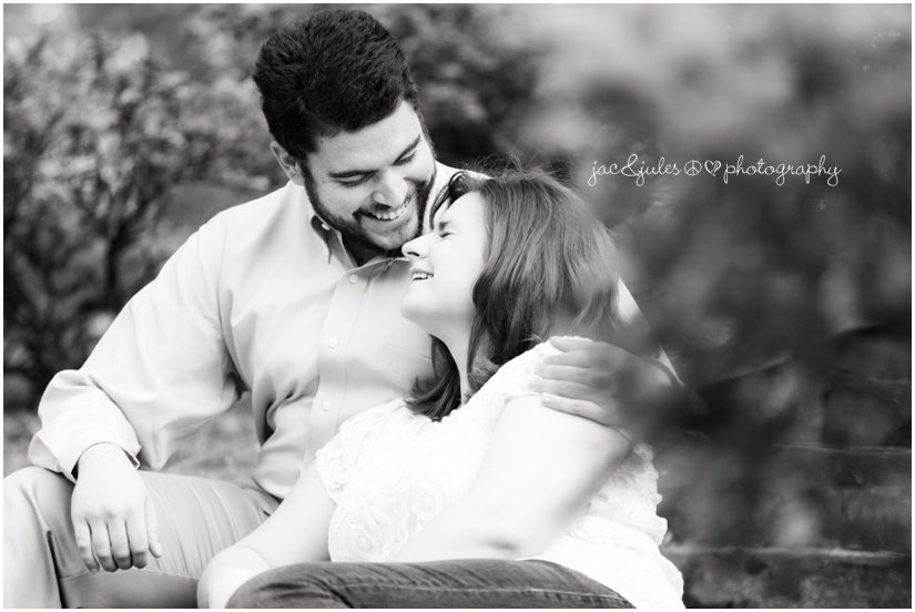 Candid moment captured in black and white of engaged couple in Island Heights, NJ photographed by JacnJules