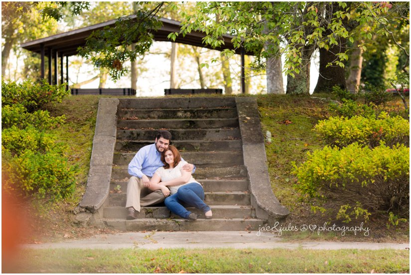 Engaged couple on staircase taken in Island Heights, NJ by JacnJules