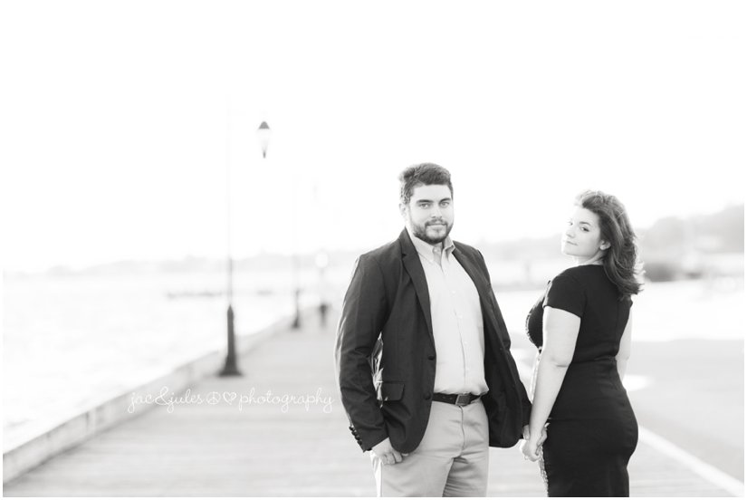 Engaged couple strolls Island Heights boardwalk in NJ photographed by JacnJules