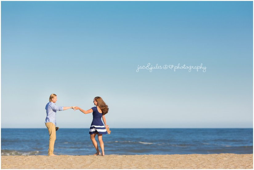 Playful photograph of an engaged couple photographed by JacnJules in Manasquan Beach, NJ
