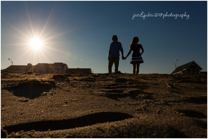silhouette of engaged couple on jetty along Manasquan Beach, NJ by JacnJules