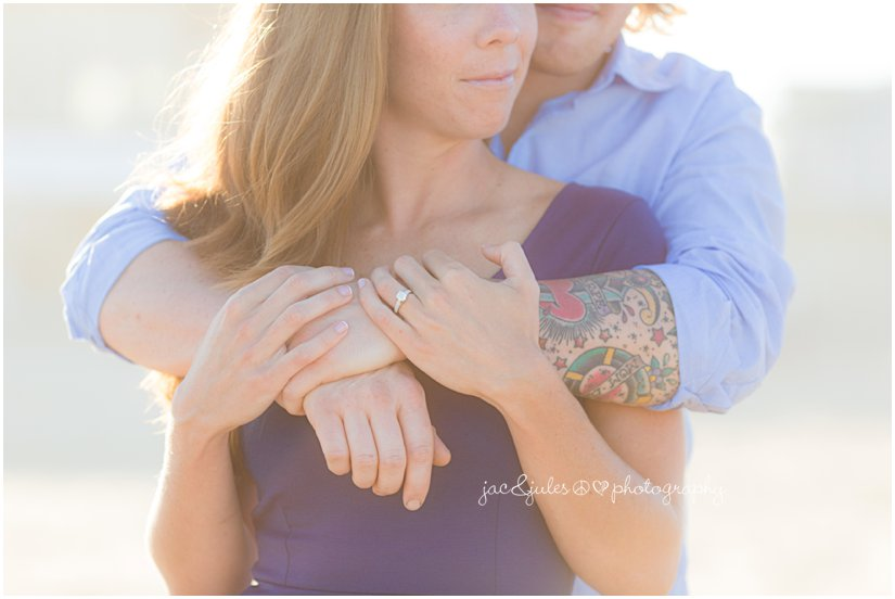 Creative close up of newly engaged couple photographed in Manasquan Beach, NJ by JacnJules