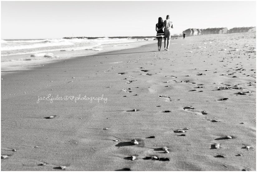 Engaged couple walking down the beach of Manasquan, NJ by JacnJules