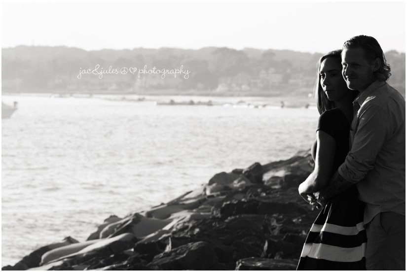 creative photograph of engaged couple on the jetty in Manasquan, NJ photographed by JacnJules