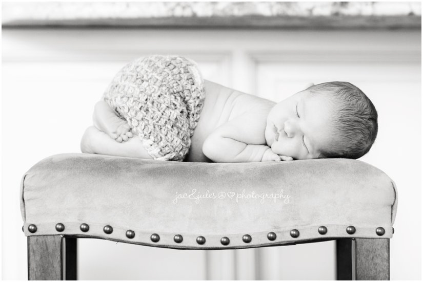 Creative newborn shot of baby on bench taken in Westfield, NJ home by JacnJules