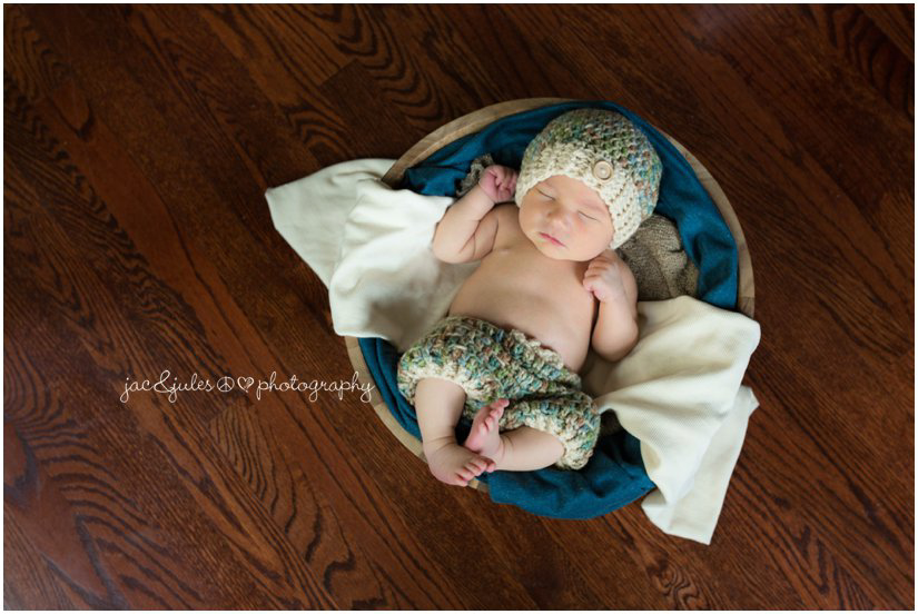 Newborn in crochet outfit taken in a Westfield, NJ home by JacnJules
