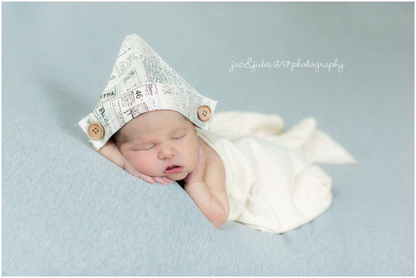 Newborn baby in paper hat taken by JacnJules in Westfield, NJ