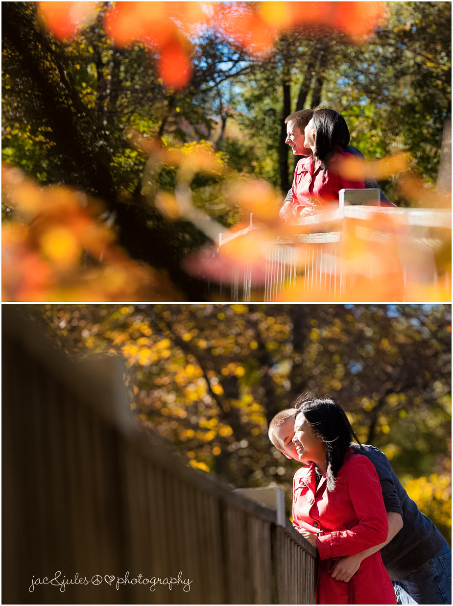 Modern shot through leaves of engaged couple on Lake Packanack bridge in Passaic County, NJ by JacnJules