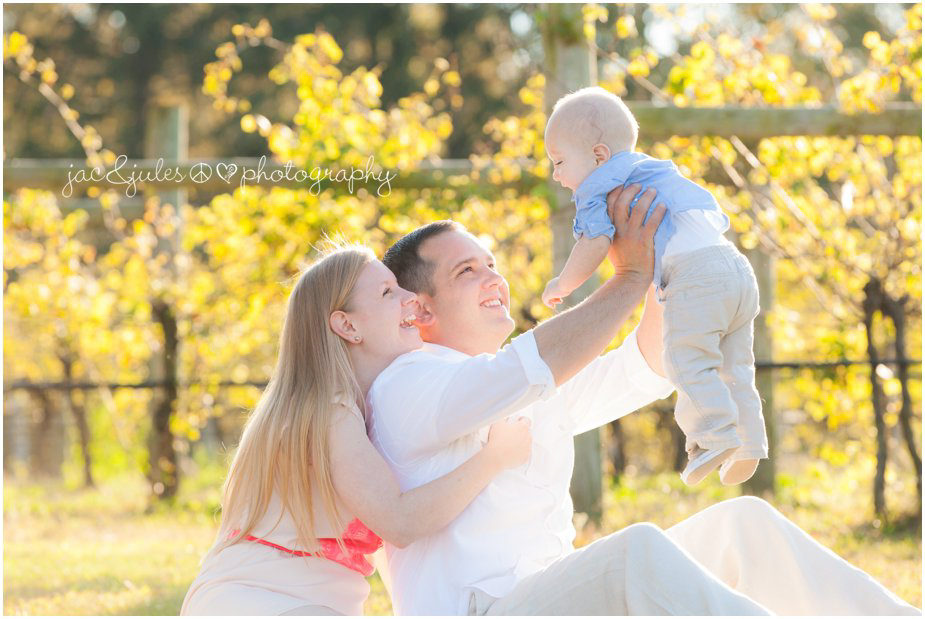 Playful family moment photographed by JacnJules at Laurita Winery in NJ