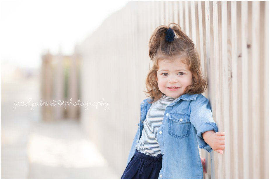 Beautiful photograph of a beautiful little girl along the boardwalk of Lavallette Beach, NJ by JacnJules
