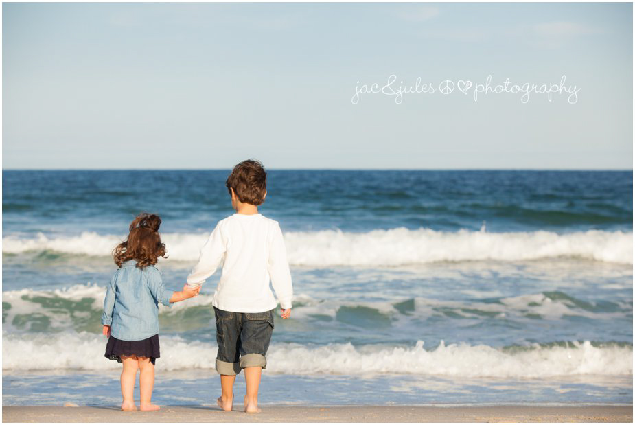 Brother and sister watching the waves together on Lavallete Beach, NJ by JacnJules