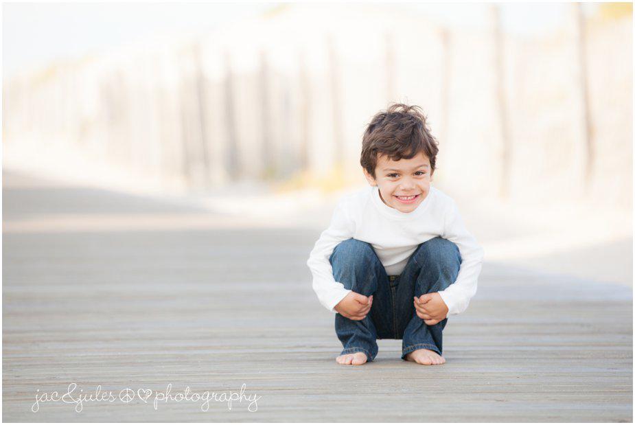 Classic portrait of a little boy along the boardwalk of Lavallette Beach, NJ by JacnJules
