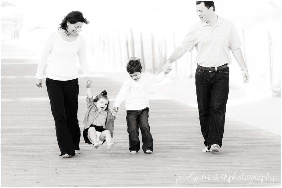 A beautiful family sports a classic look of barefoot and blue jeans on Lavallette Beach, NJ by JacnJules