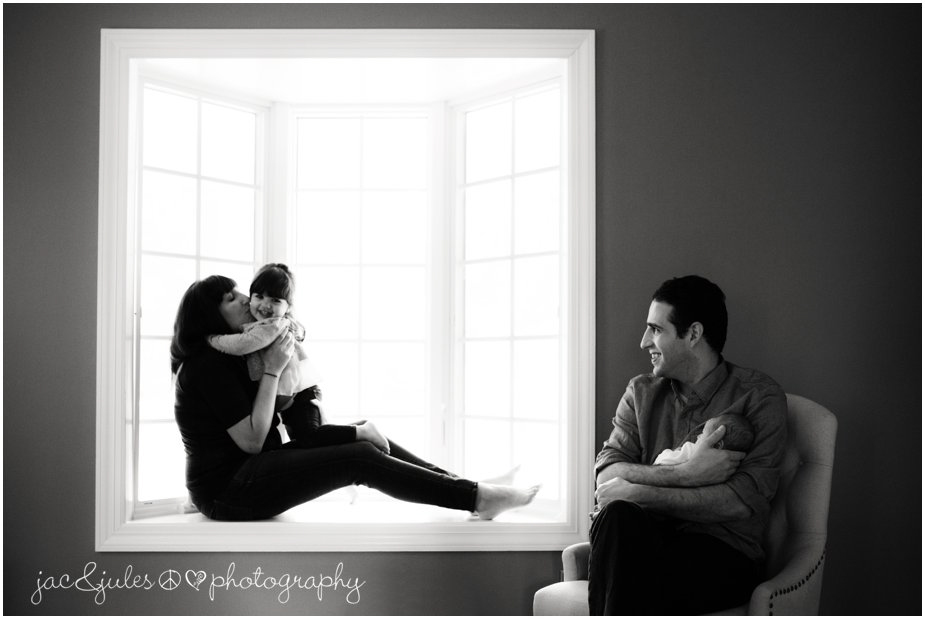 Modern black and white family photo with newborn baby taken in Monmouth, NJ by JacnJules