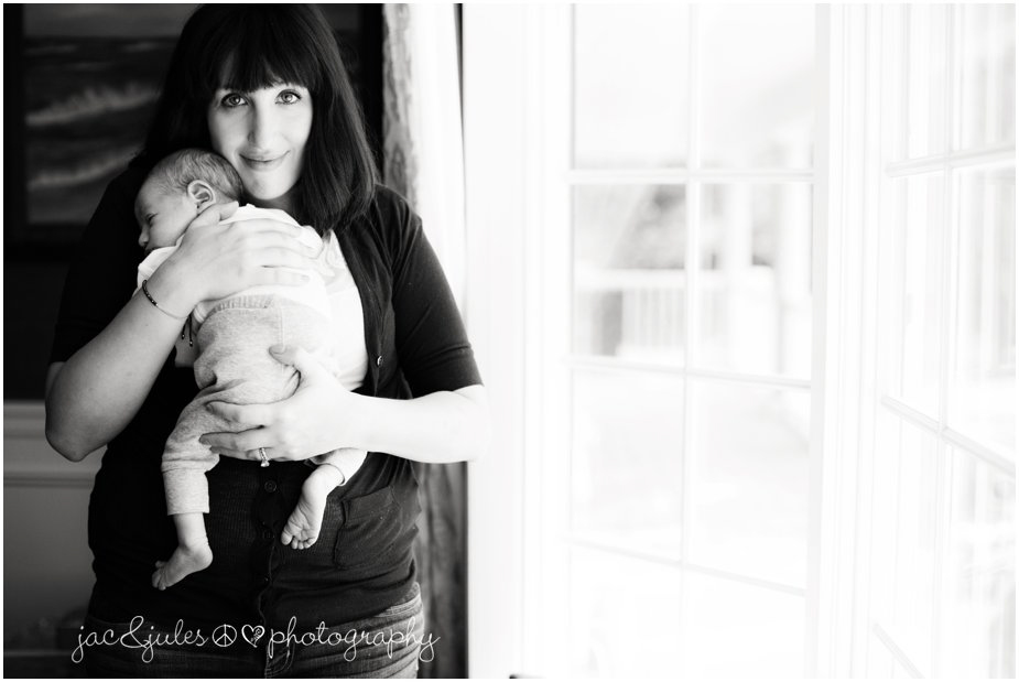 Black and white photo of a mother and her newborn photographed by JacnJules in Monmouth, NJ