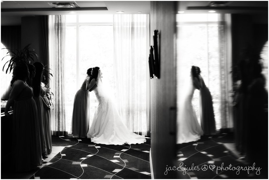 bride and sister moment at the heldrich in new brunswick nj by jancjules
