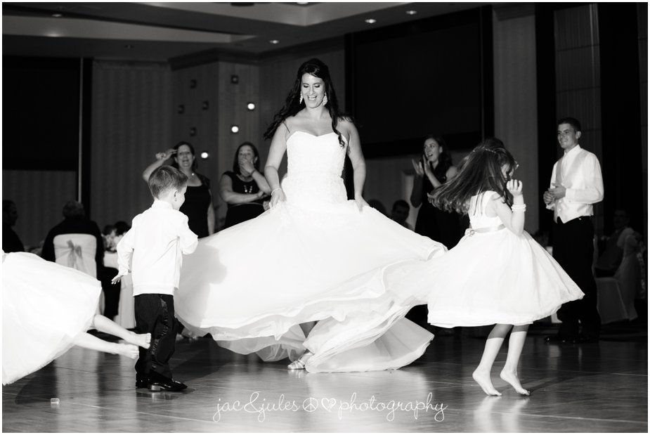 bride spinning in her wedding dress at the heldrich hotel in new brunswick nj by jacnjules