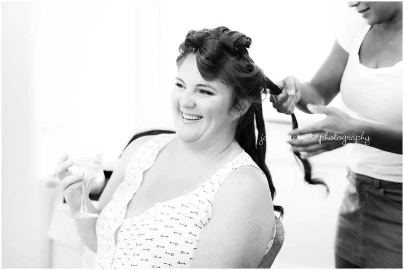 Bride having fun getting her hair done for her special day photographed by JacnJules at the Mansion at Bretton Woods in Morristown, NJ