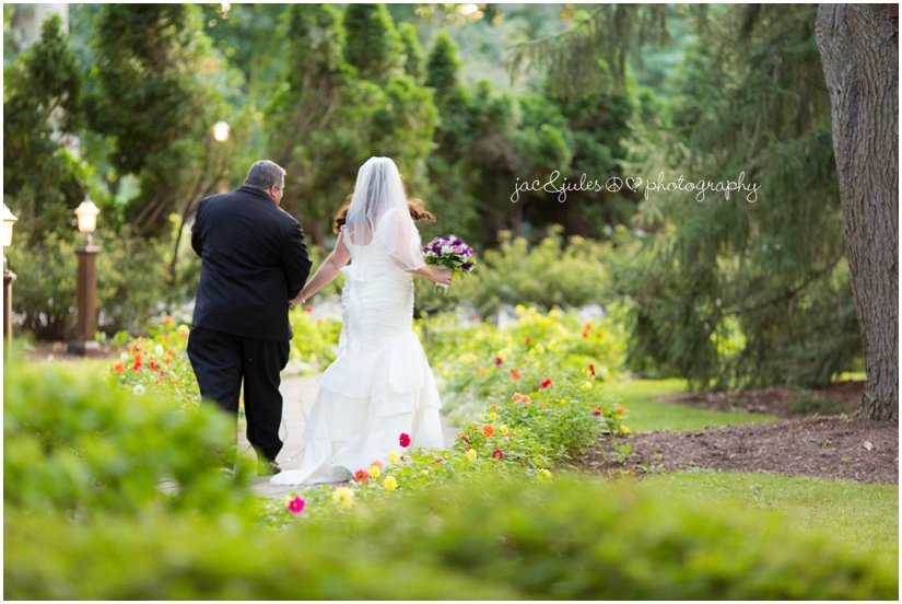 Bride and groom walking through garden at the Mansion at Bretton Woods in Morristown, NJ by JacnJules